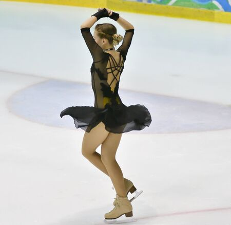 Girl skater skates on ice sports arena