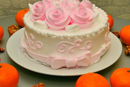 Festive cake with roses made of cream