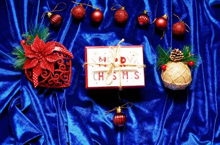 Christmas decorations and a gift on a blue background