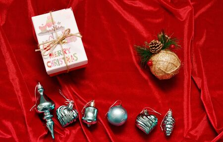 Christmas decorations and a gift on a red background