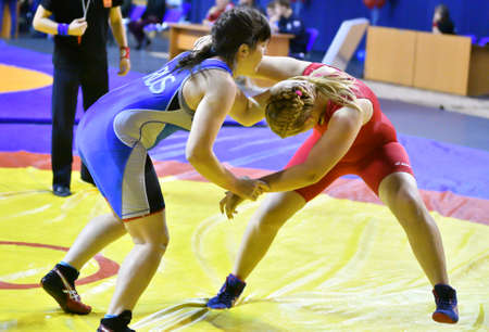 Orenburg, Russia - October 25-26, 2017: Girls compete in sports wrestling at the All-Russian tournament for the prizes of the Governor of Orenburg Region