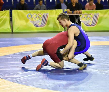 Orenburg, Russia - March 15-16, 2017: Young men compete in the sports wrestling at the Volga Federal District Championship in sports wrestling Редакционное