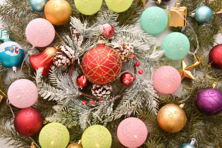 Colorful Christmas garland and decorative decorations for the Christmas tree Фото со стока