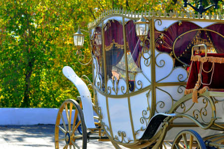 Vintage wedding carriage on the street of the city in the daytime Editorial
