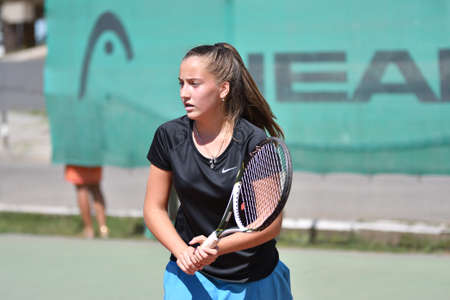 Orenburg, Russia - August 15, 2017 year: girl playing tennis on the prizes of the Tennis Federation of the Orenburg region