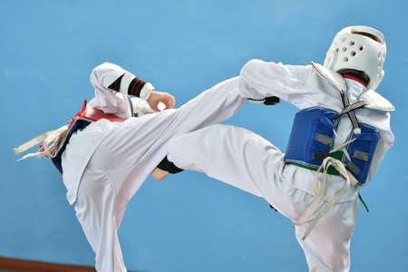 Boy compete in taekwondo (Korean martial arts)