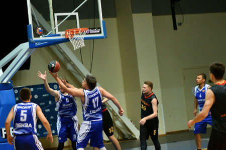 Orenburg, Russia - 13-16 June 2019 year: Men play basketball on Interregional finals of the amateur Basketball League in Volga Federal District Editorial