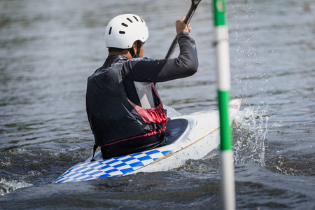 paddles: Kayak racer goes towards finish line during competition, europe.
