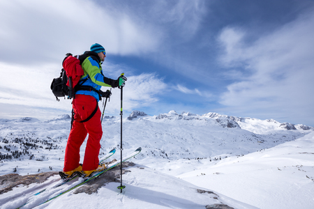 Ski mountaineer watches his goals in the mountains. Mountain peaks in the background. Dachstein, Austria.