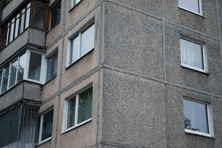 Facade of social housing in a residential area of the city. Close-up.