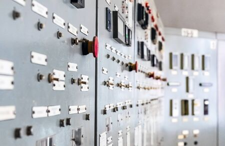 Industry. Regulation and control elements on the control cabinet. Close-up.