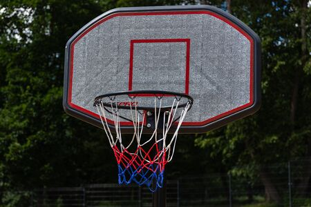 Close-up of a basketball basket in a city park.