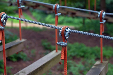 Rope holding a log bridge, part of the cableway. Close-up. Extreme sport.