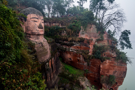 View of the Buddha statue in Leshan, China. Leshan Buddha is the worlds largest statue of Buddha, whose height is 71 meters.