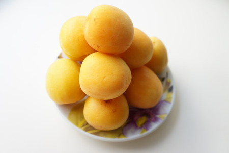 small plate: Ripe apricots on a small plate