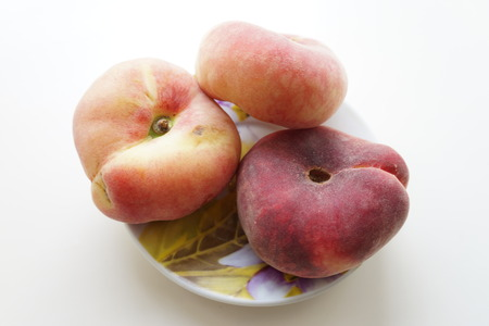 fruit plate: Ripe peaches on a small plate