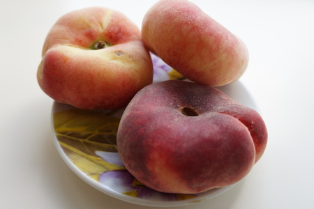 small plate: Ripe peaches on a small plate
