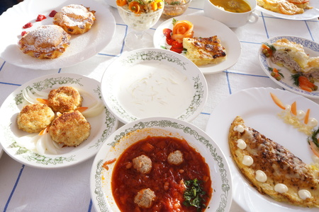 cluttered: table cluttered with plates of various dishes