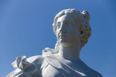 Russia. Vyborg. 06.30.2020. Statue of a woman on a background of blue sky. High quality photo Archivio Fotografico