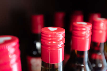 bottles with red corks and with a pattern of a white heart. soft focus effect. High quality photo Banque d'images