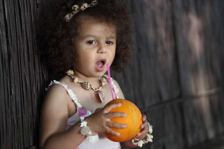 curly girl drinks a tropical drink