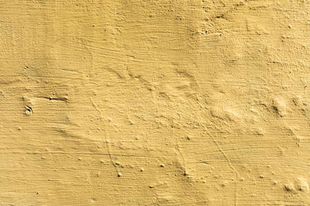 stone wall with yellow texture paint 写真素材