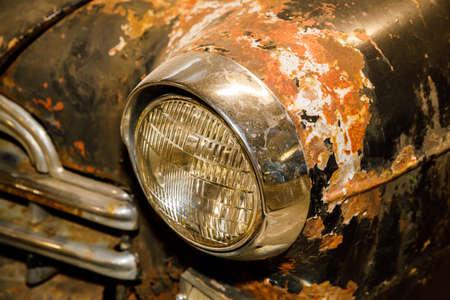 old rusty retro car of black color.