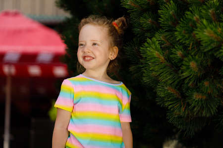 red-haired girl in a striped colored T-shirt.