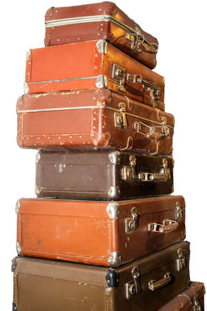 stack of old retro suitcases isolated on white background