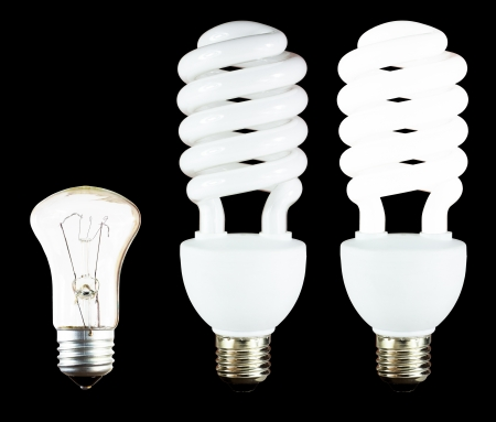 tungsten:  One tungsten and two fluorescent energy saving lamps isolated on black Stock Photo
