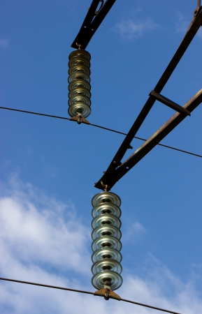 Two composite glass insulators on high voltage stand photo