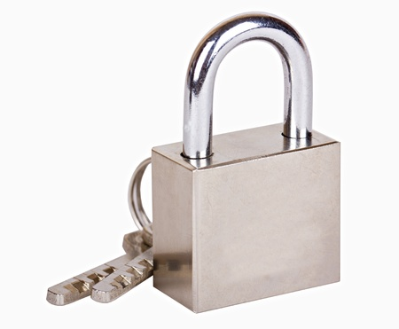 The metal closed padlock with two keys isolated on white photo