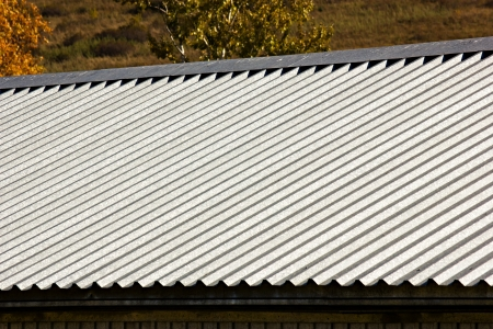 The gray corrugated roof of a building photo