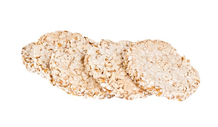 popped: The heap of popped buckwheat slices isolated on a white background Stock Photo