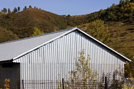 Building with gray metallic corrugated roof and walls photo