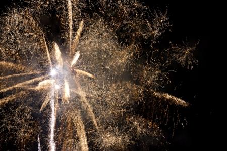 threadlike: Yellow threadlike fireworks against the night sky background Stock Photo