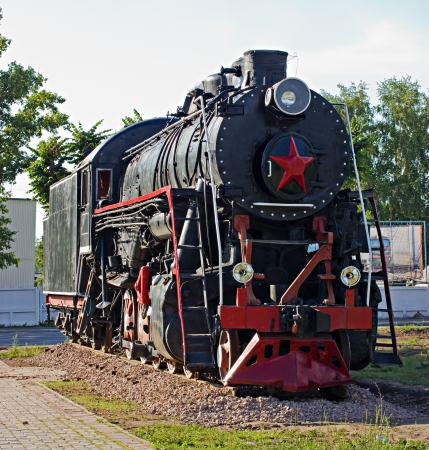 Old black soviet locomotive as a monument