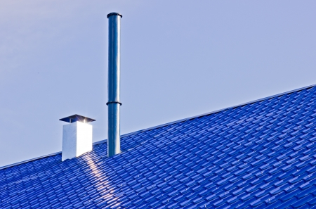 Blue roof with pipes by the summer photo