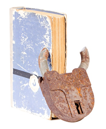 Old book with an old rusty padlock with cut ear without keys isolated on white background photo