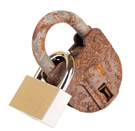 Old padlock and new padlock linked and isolated on white background Stock Photo - 21618593