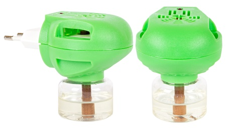 Green fumigator with repellent bottle, two different views isolated on white photo