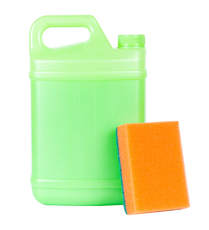 Green plastic closed canister with handle and with orange sponge isolated on white photo
