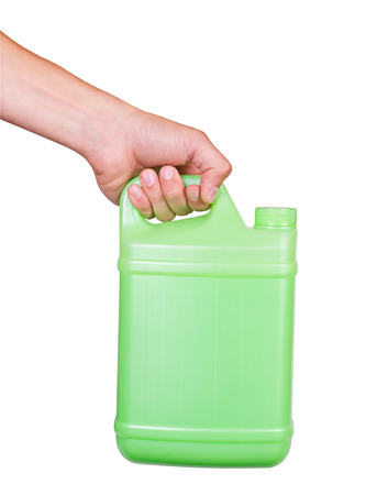 Hand with green closed plastic canister with handle isolated on white photo