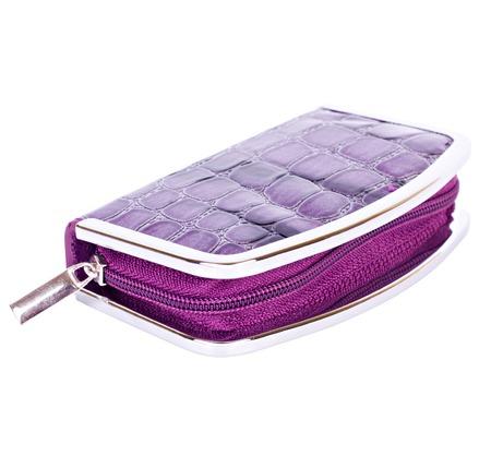 Manicure set closed purple case with imitation of alligator leather isolated on white background photo