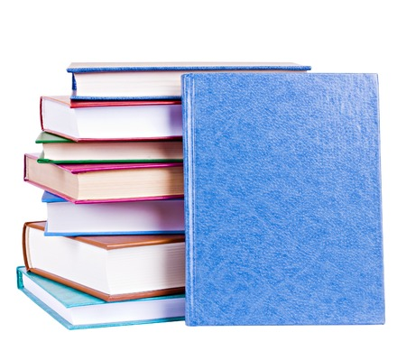 Colorful books heap and blue book with hardcover standing before them isolated on white photo