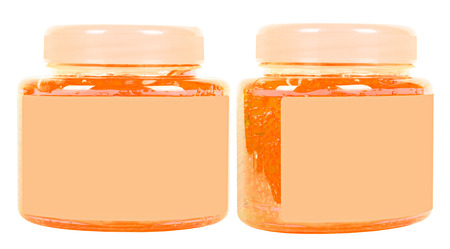 Two orange washing gel jars with bubbles inside with caps isolated on white photo