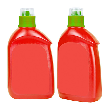 Two red closed plastic soap bottles isolated on white photo