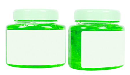 Two green washing gel jars with bubbles inside with caps isolated on white photo