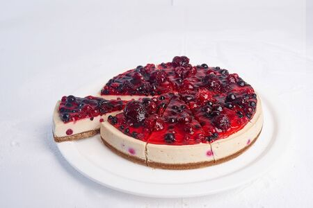 Tasty big piece of cake on a plate on a white background
