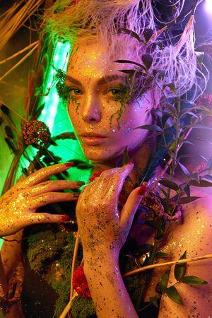 Fantasy world, a fabulous beautiful woman nymph or elf looks